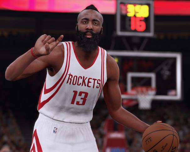"""En esta foto podemos ver la imagen que NBA2K16 ha diseñado del Campeón del Mundo y Jugador de los Houston Rockets, James Harden, donde le vemos conduciendo el balón y marcando jugada (""""la 1""""), con la canasta y el marcador del tiempo restante de cuarto y de posesión de fondo"""